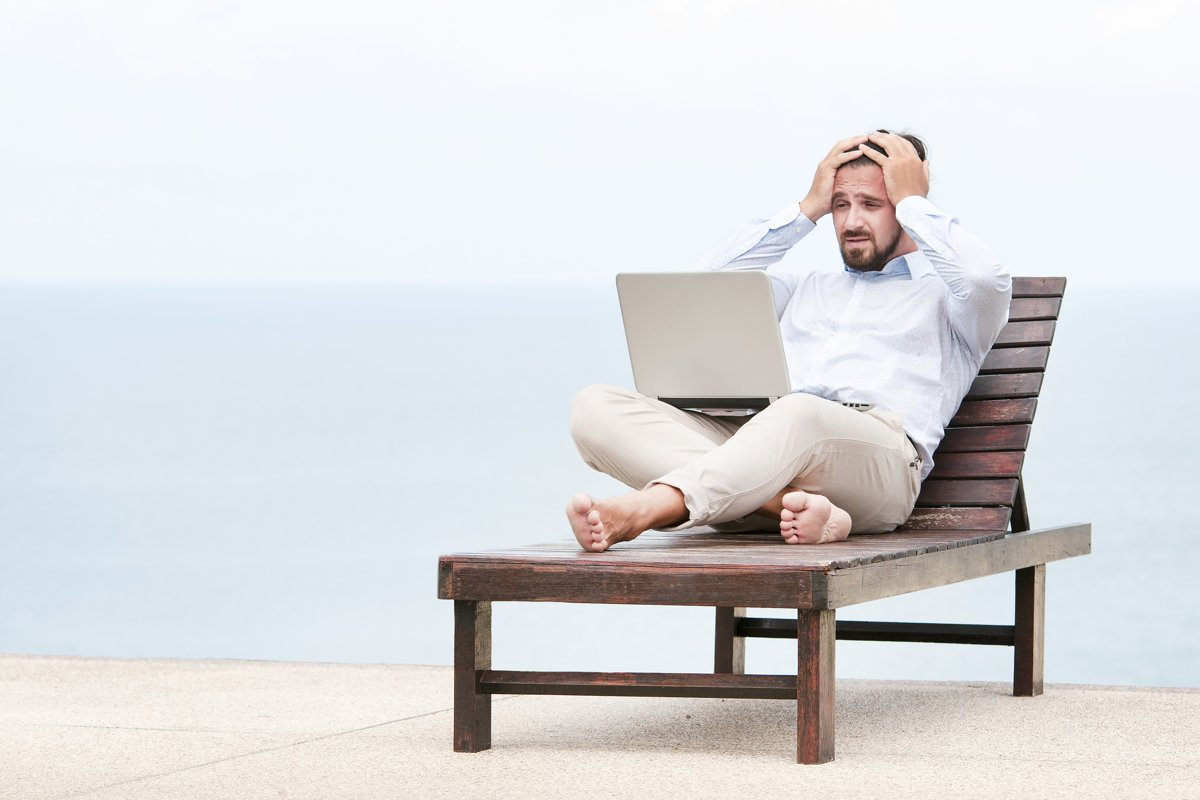 Businessman freelance on beach with laptop example image 1