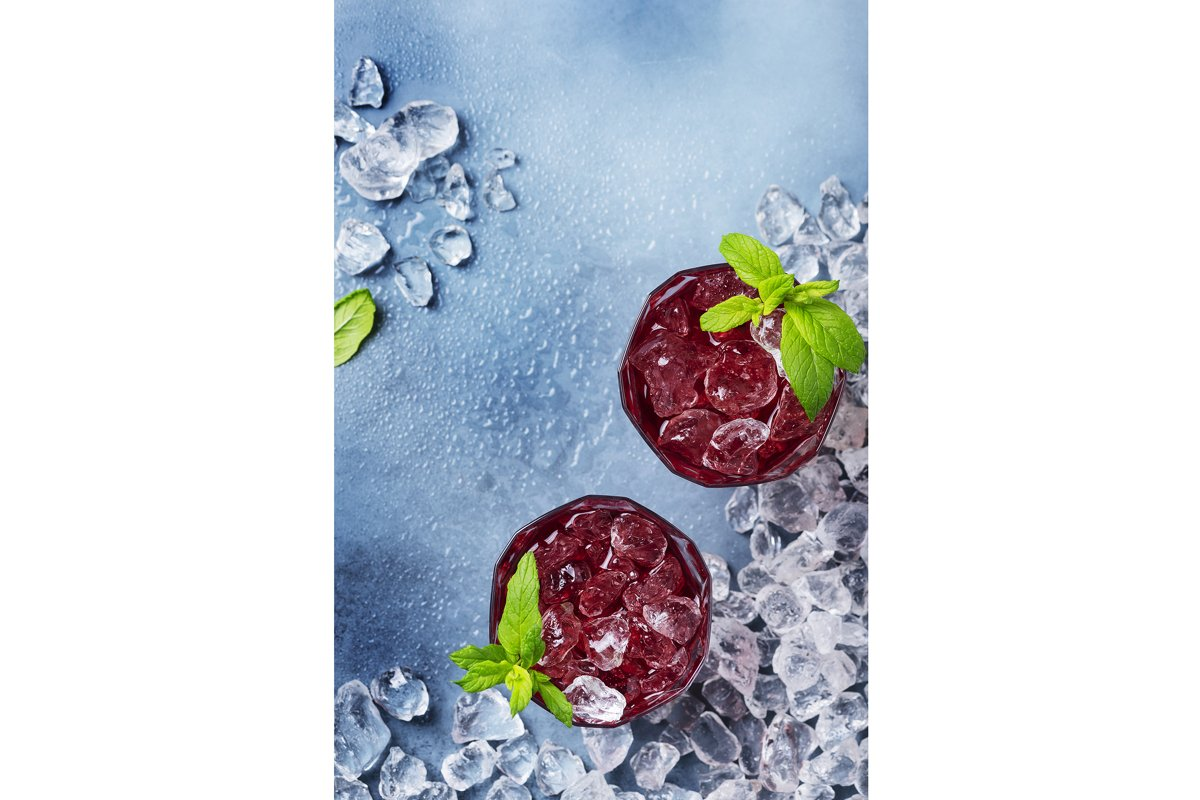 Top view image of a red cocktail with ice and mint example image 1