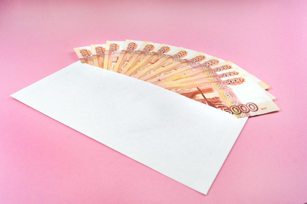 envelope with Russian currency on a pink background example image 1