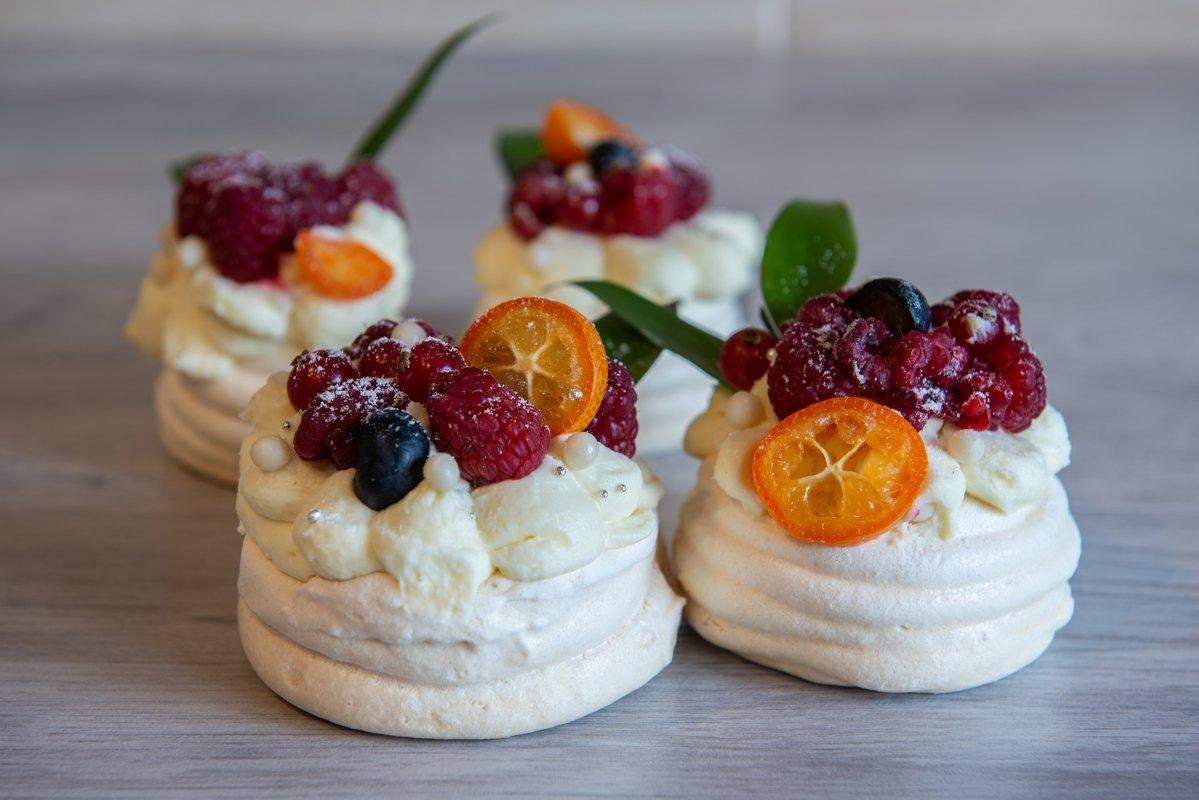 Pavlova meringue cake with cream and small fruits example image 1