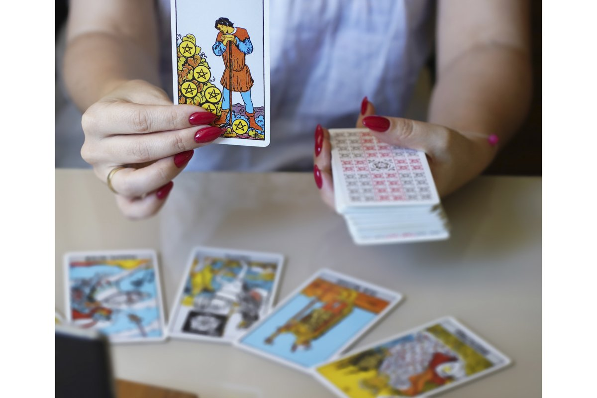 Tarot reader picking tarot cards. example image 1