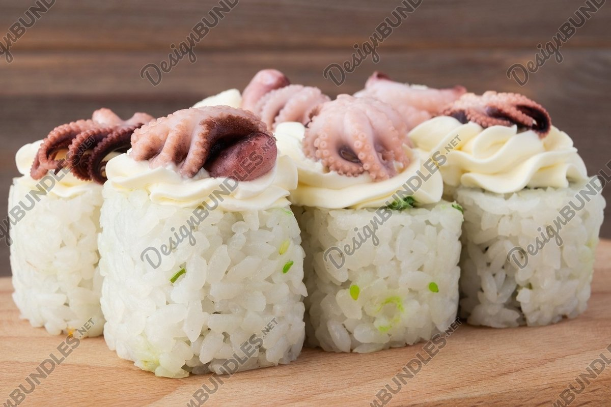 Sushi, rolls set with octopus close-up on a wooden table example image 1