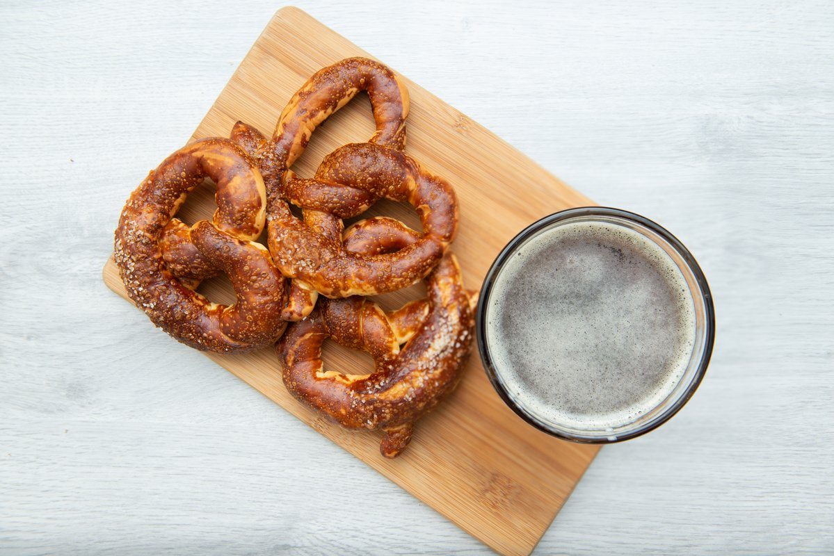 Freshly baked homemade soft pretzel with salt and glass beer example image 1