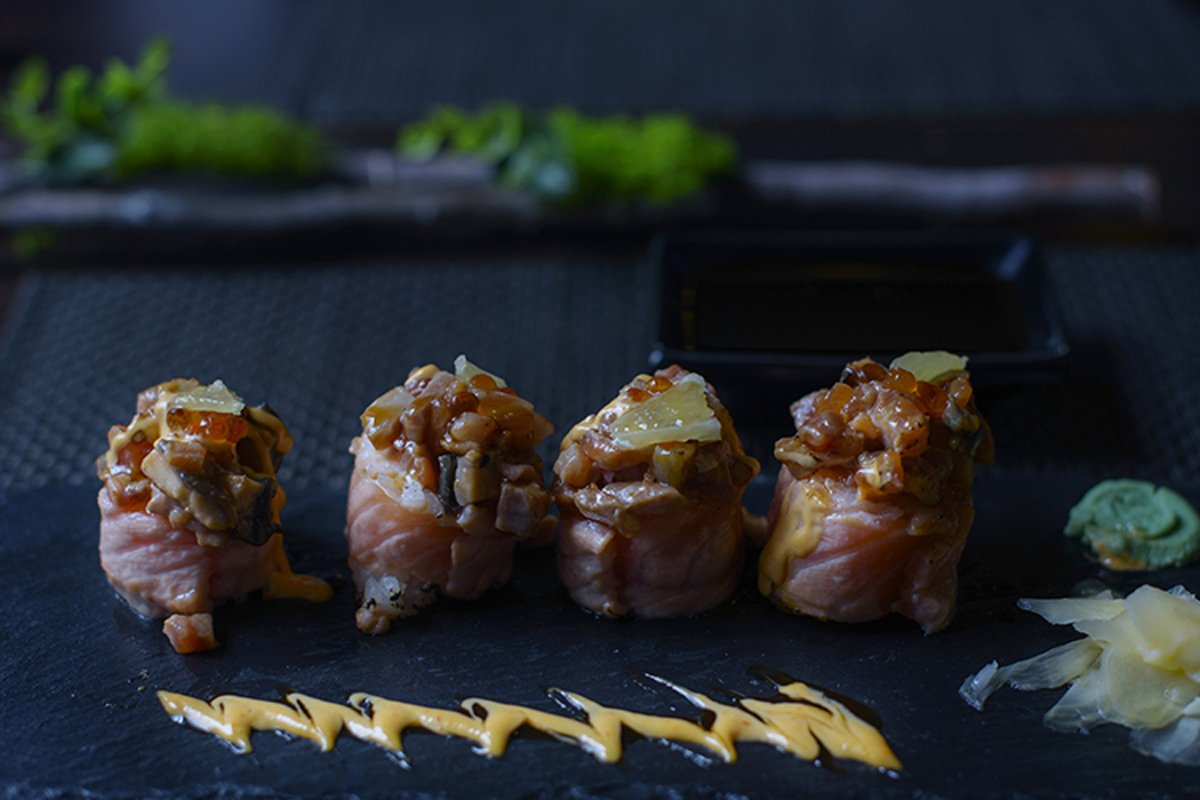seared salmon and eel sushi rolls on dark background example image 1