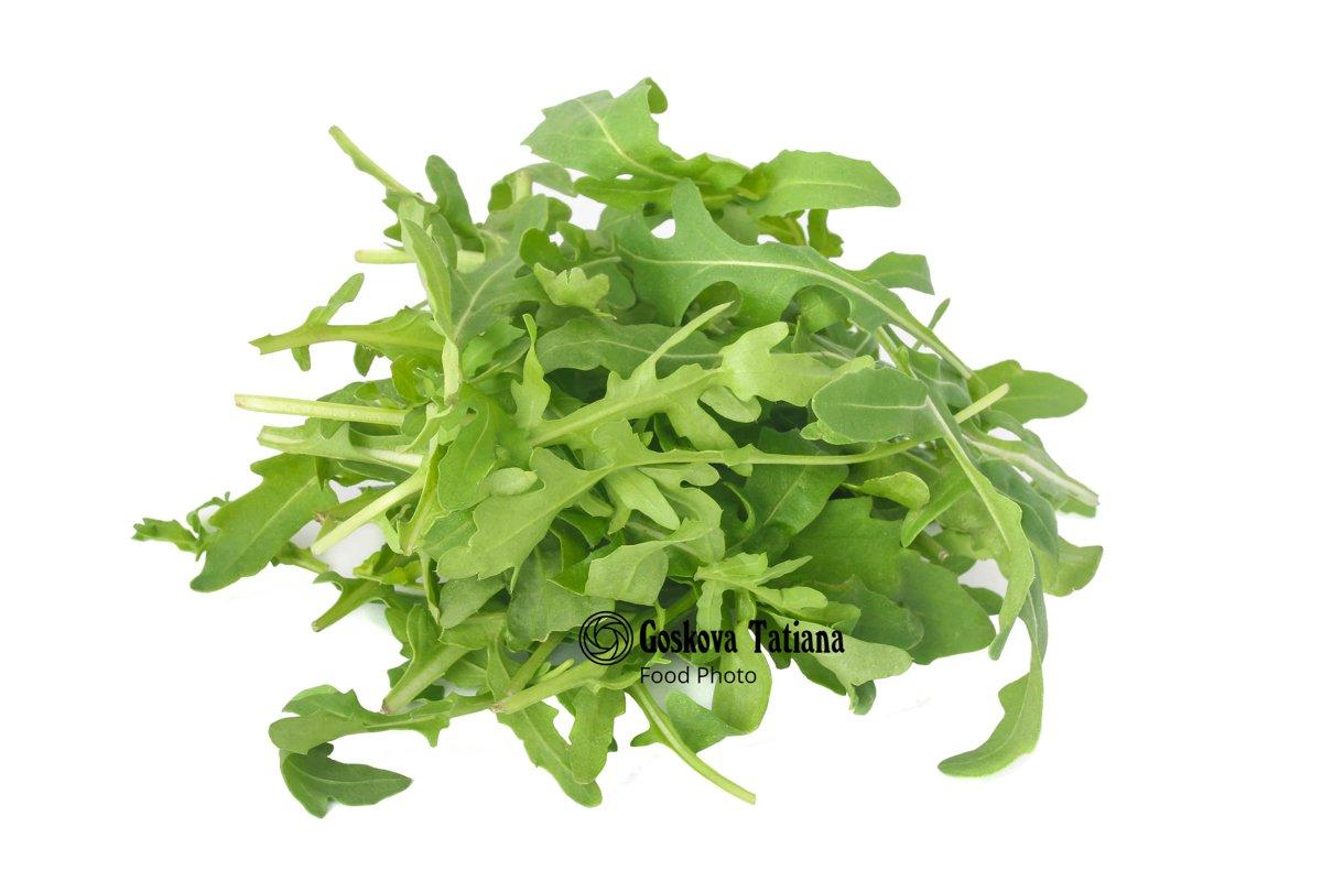 Photo of bunch of fresh arugula leaves isolated on white example image 1