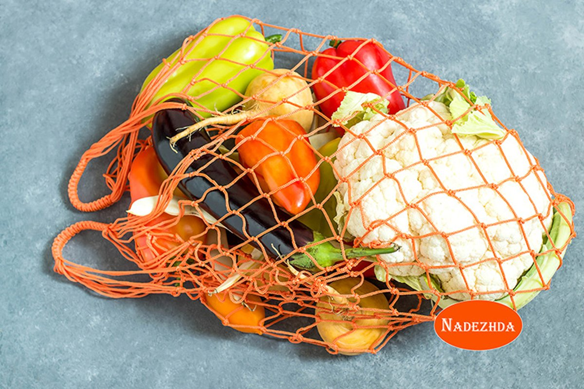 String bag with various fresh vegetables example image 1