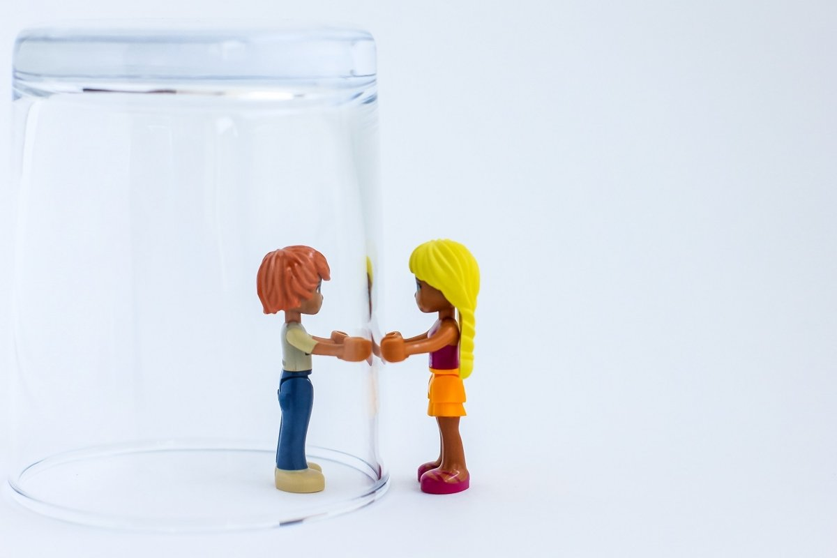 Toy people under a glass. example image 1