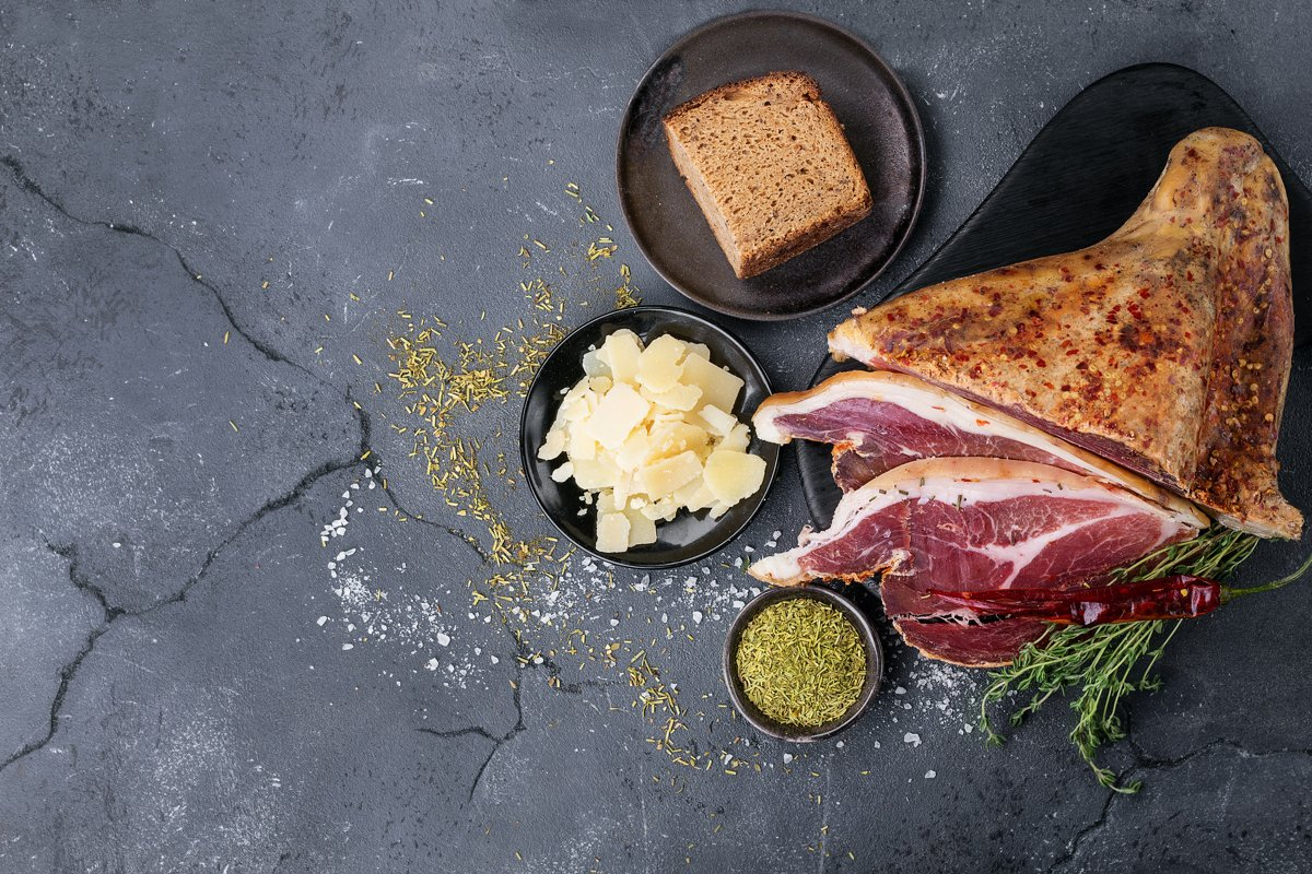 Prosciutto Ham served on a rustic wooden board example image 1