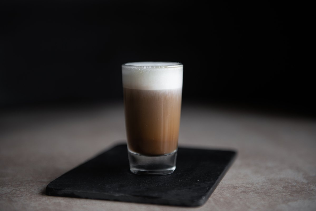 mini cup of cappuccino in a glass cup on black background example image 1