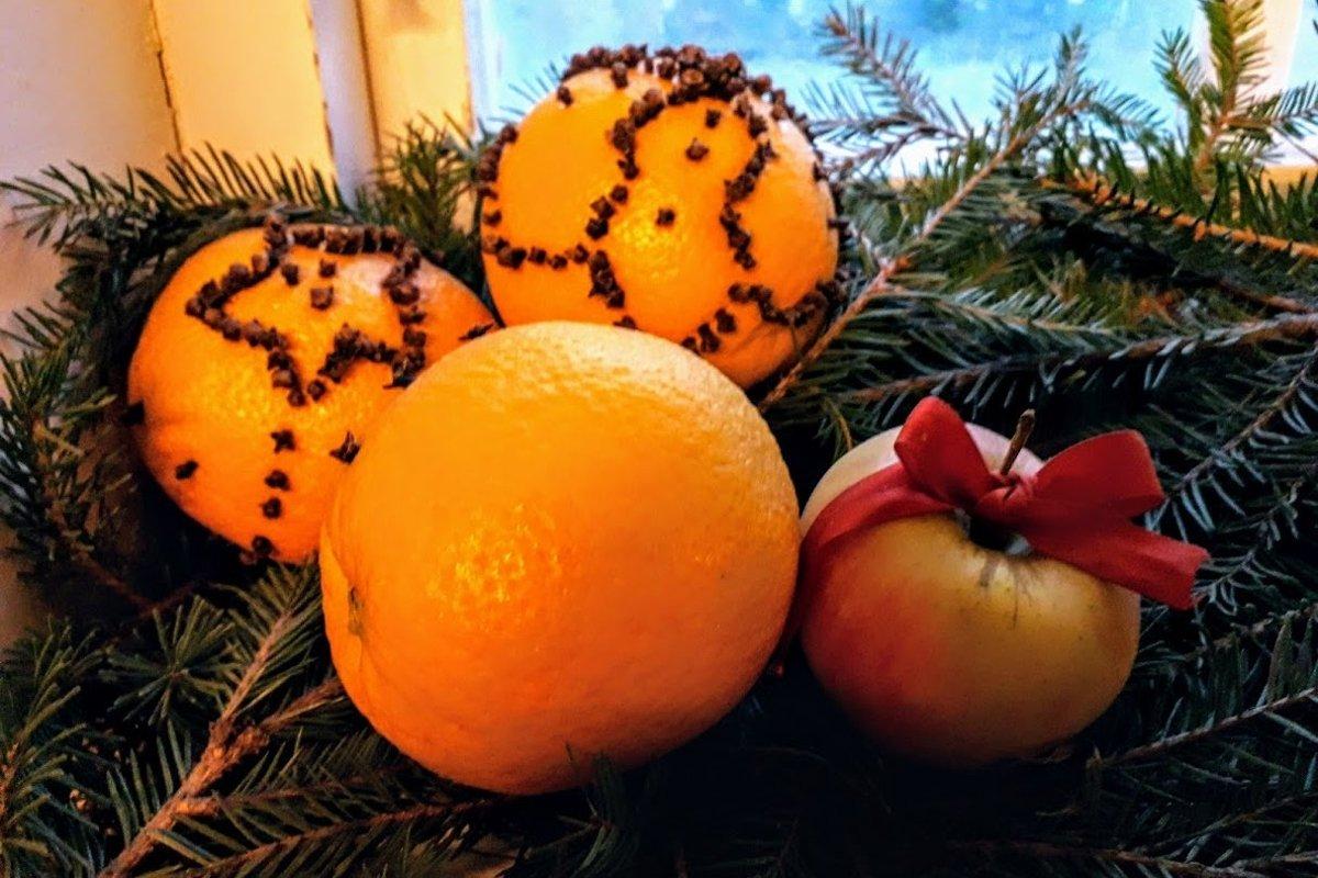 Christmas photos Orange pomander on Christmas tree branches example image 1