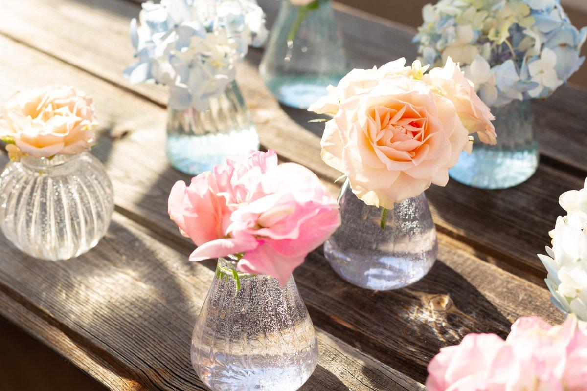 Blue hydrangea,pink sweet pea Lathyrus,roses in crystal vase example image 1