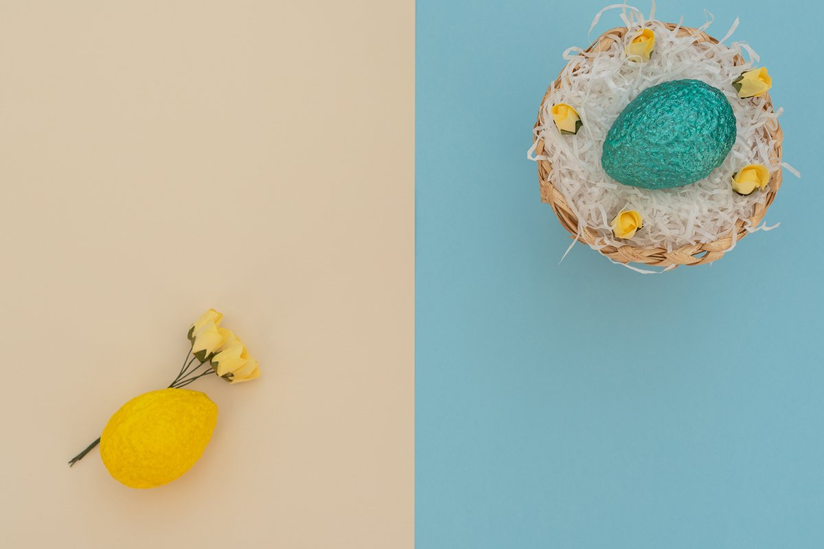 Colored blue Easter egg in egg basket with white paper example image 1