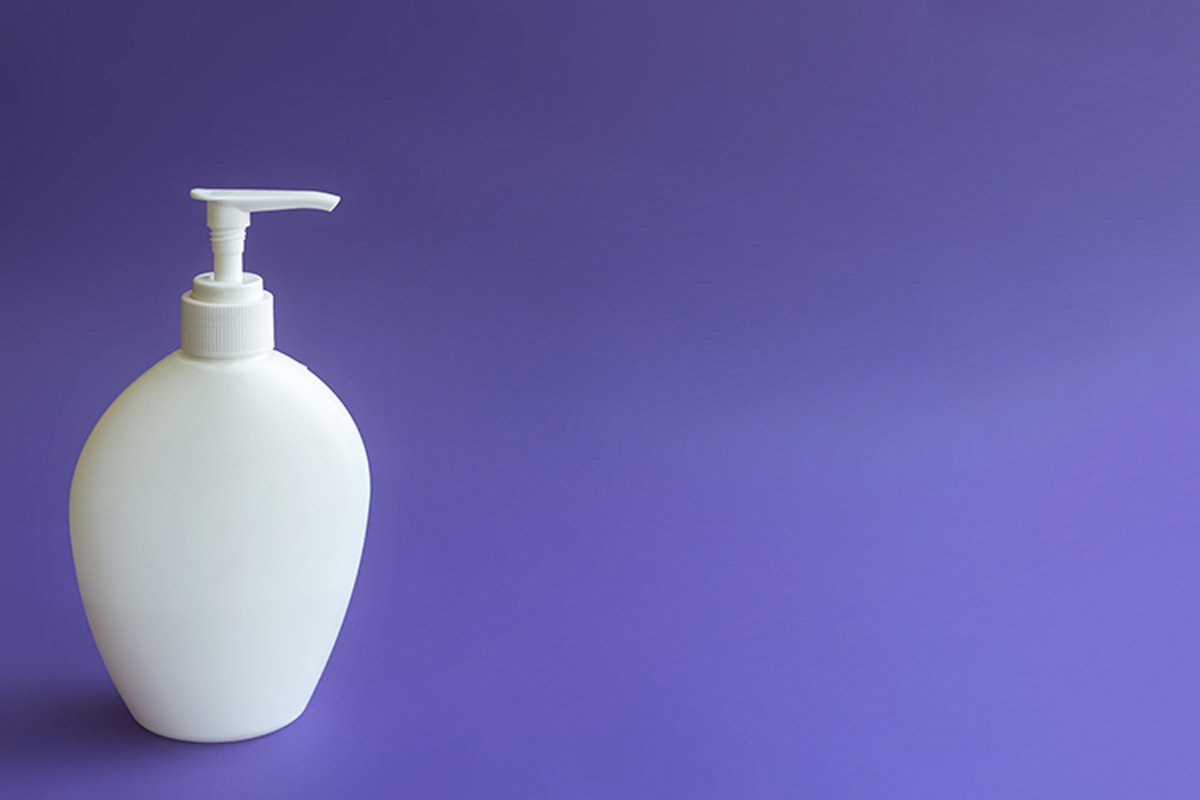 Empty bottle layout with a dispenser on a purple background. example image 1