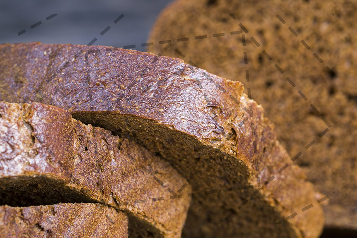 Cut loaf of bread. example image 1