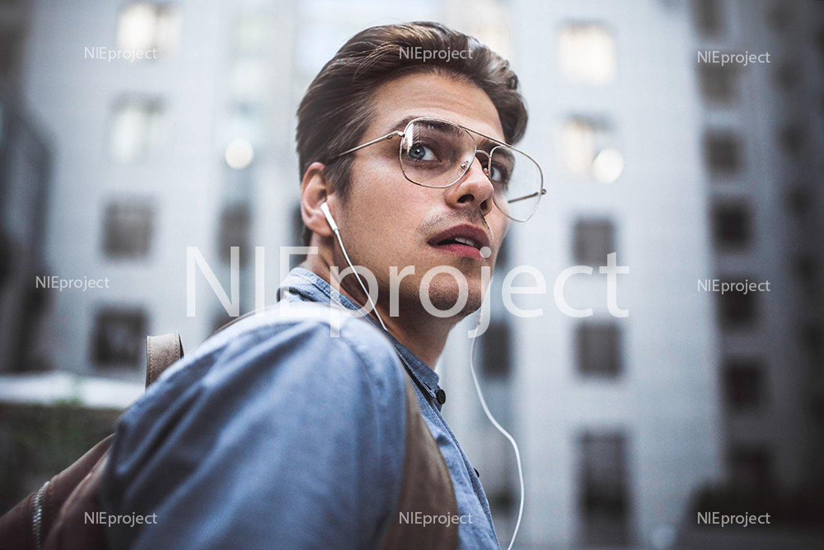 Happy man listening to music with headphones example image 1
