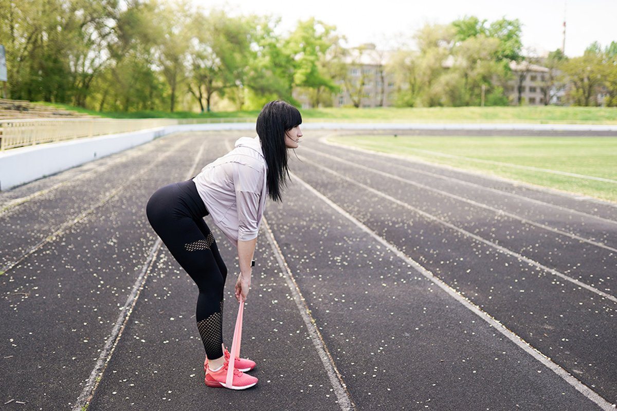 sport and lifestyle concept - woman doing sports outdoors. example image 1