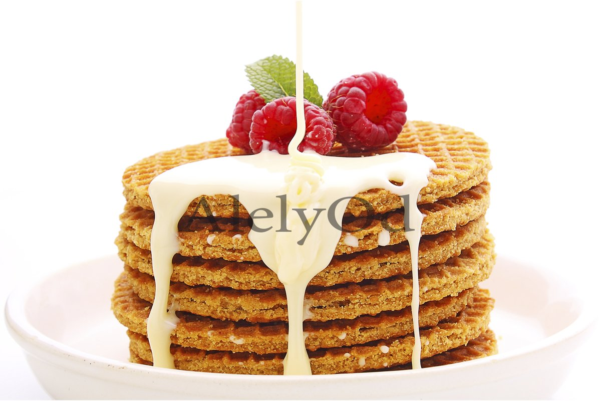 Breakfast waffles with raspberries and syrup, decorated wit example image 1
