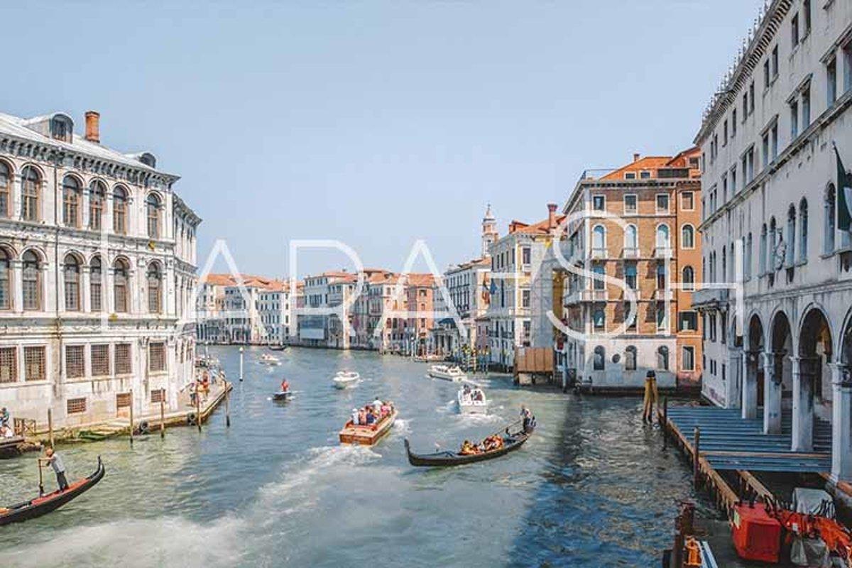 Gondolas on narrow canal in Venice, Italy. example image 1