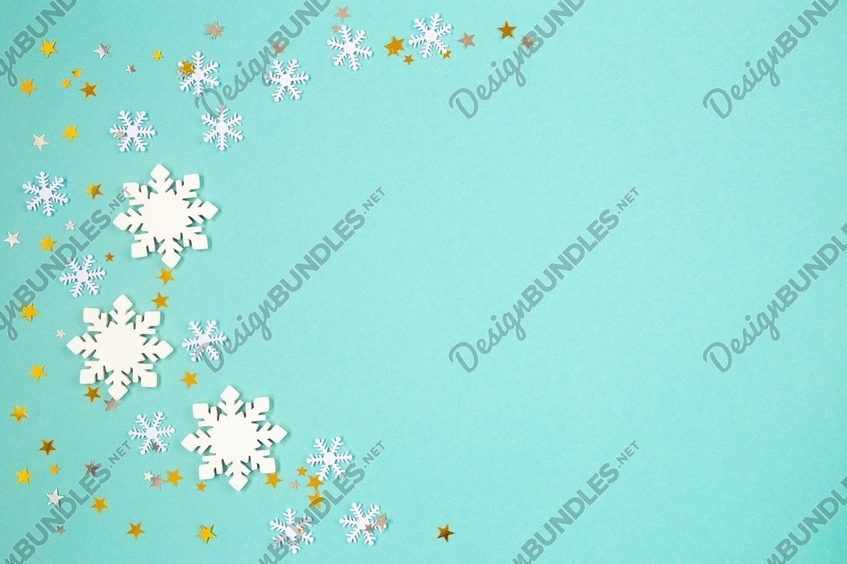 Flat lay photo of snowflake backgrounds on green paper example image 1