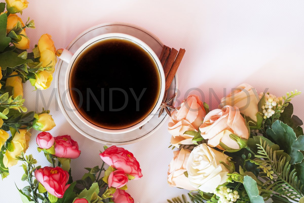 Flat Iay. Cup of coffee with cinnamon on a white background example image 1