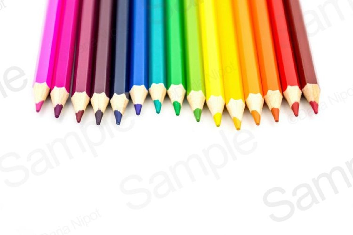 Rainbow color pencils on white background example image 1
