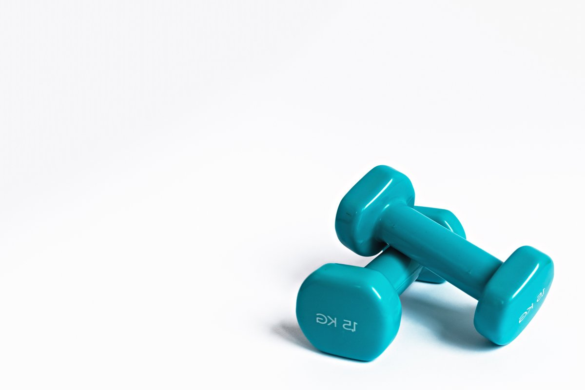 Blue dumbbells for fitness on a white background. example image 1