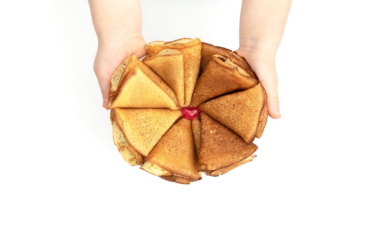 The flower made of homemade pancakes in childs hands example image 1