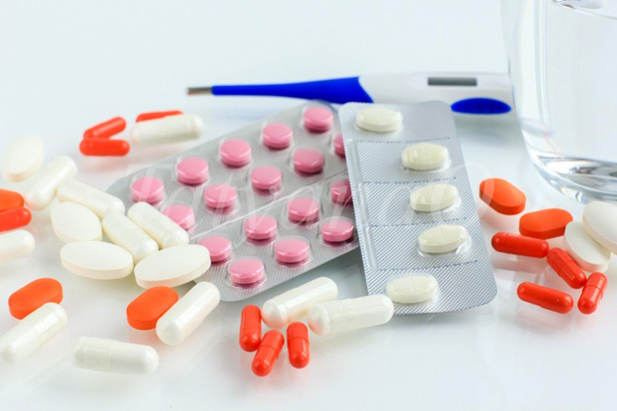 Multicolored pills, tablets against the virus, flu, disease example image 1