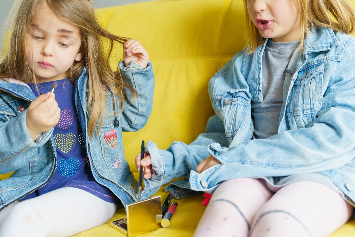 Hipster fashionable girls in denim jackets do mom's make up example image 1