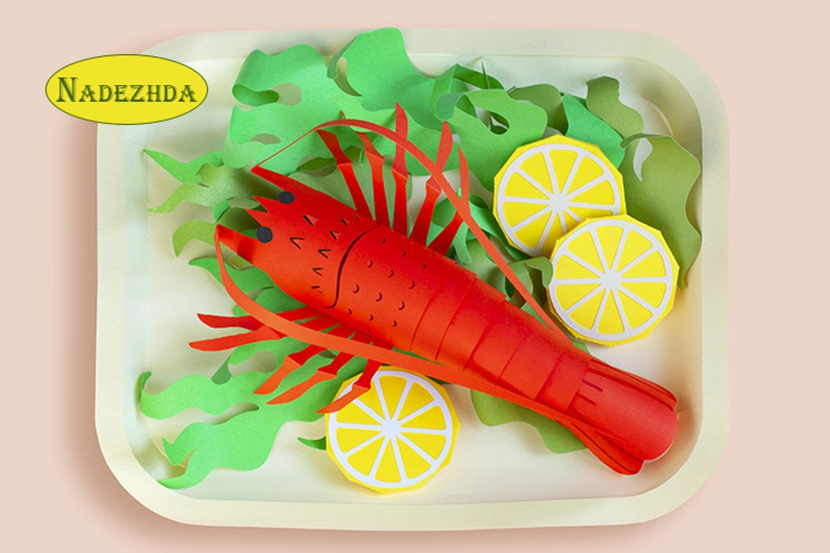 Paper spiny lobster with lettuce and lemon slices example image 1