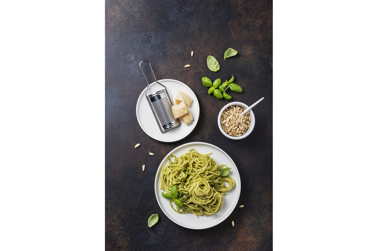 Traditional Italian spaghetti with basil cream pesto. example image 1