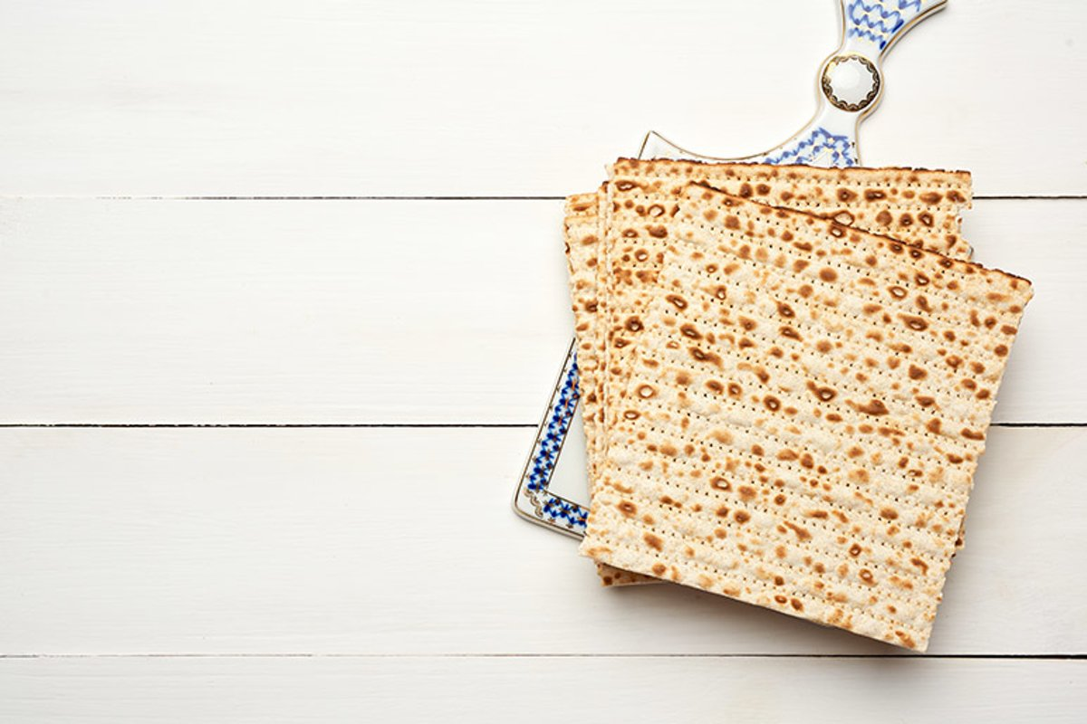stack of baked square matzo on a white wooden background example image 1