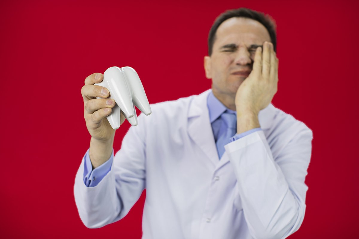 Doctor therapist with a stethoscope on a red background example image 1