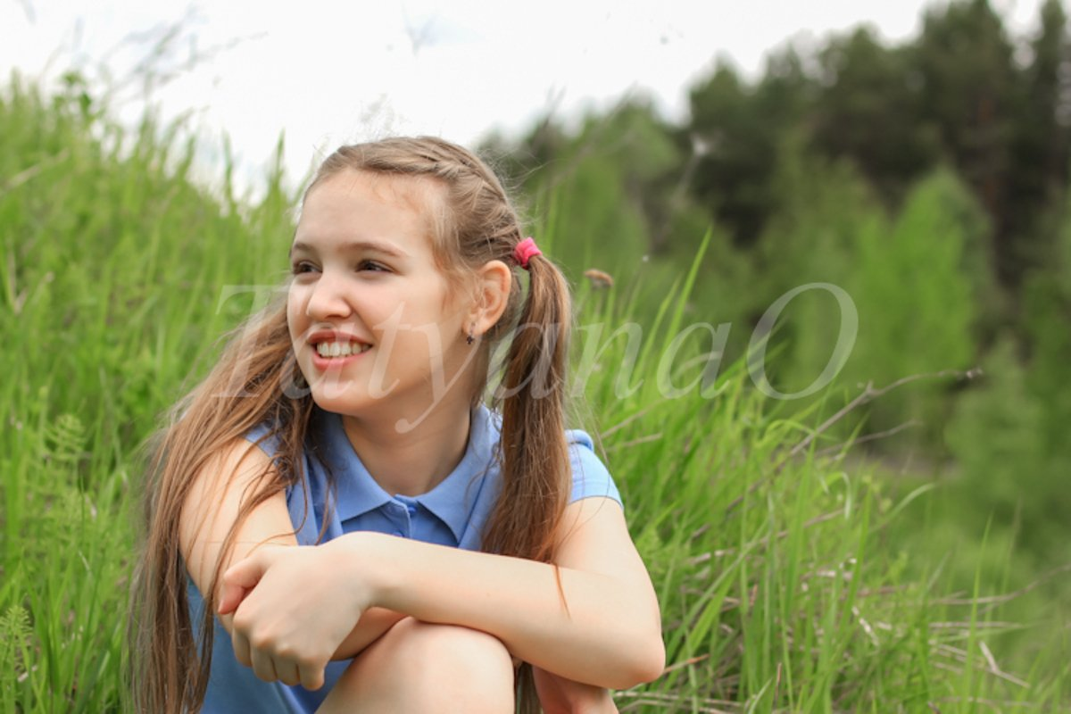 A young beautiful girl, a teenager walking in the Park example image 1