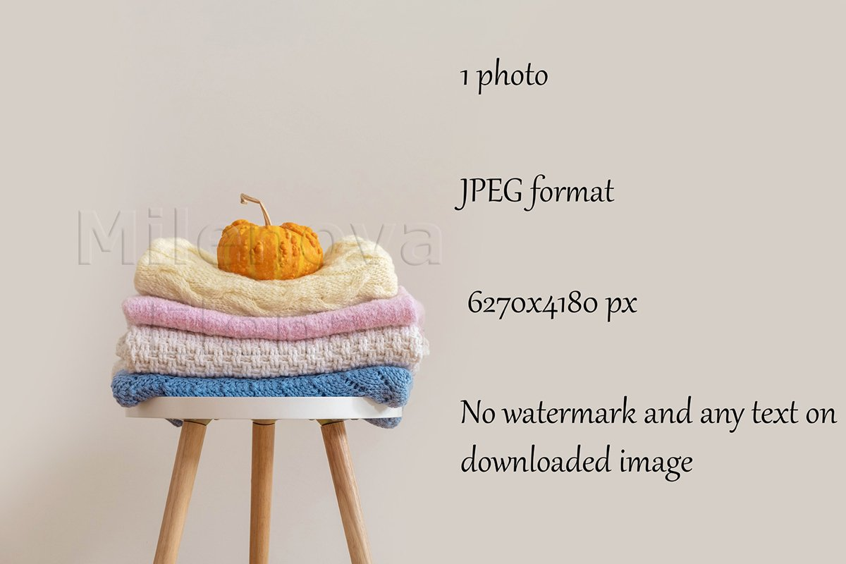 Pile of handmade knitted sweaters blankets folded on chair example image 1