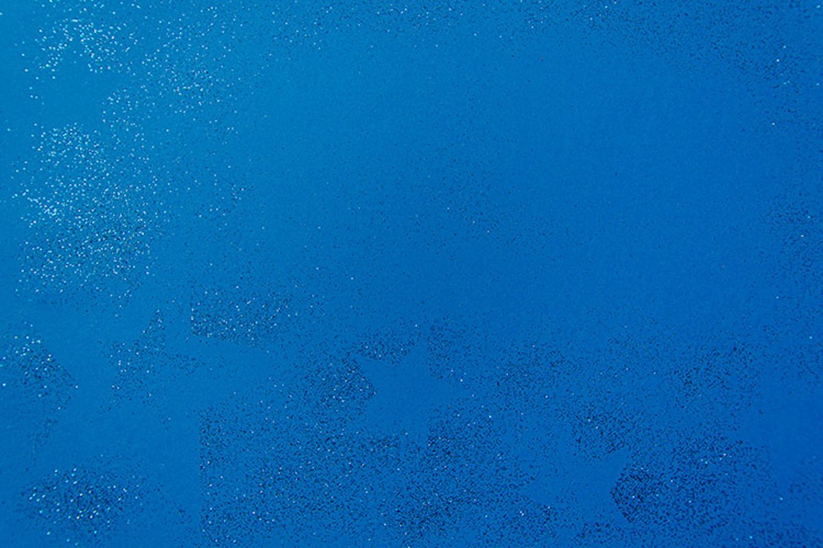 Silver sparkling christmas decoration on blue background. example image 1