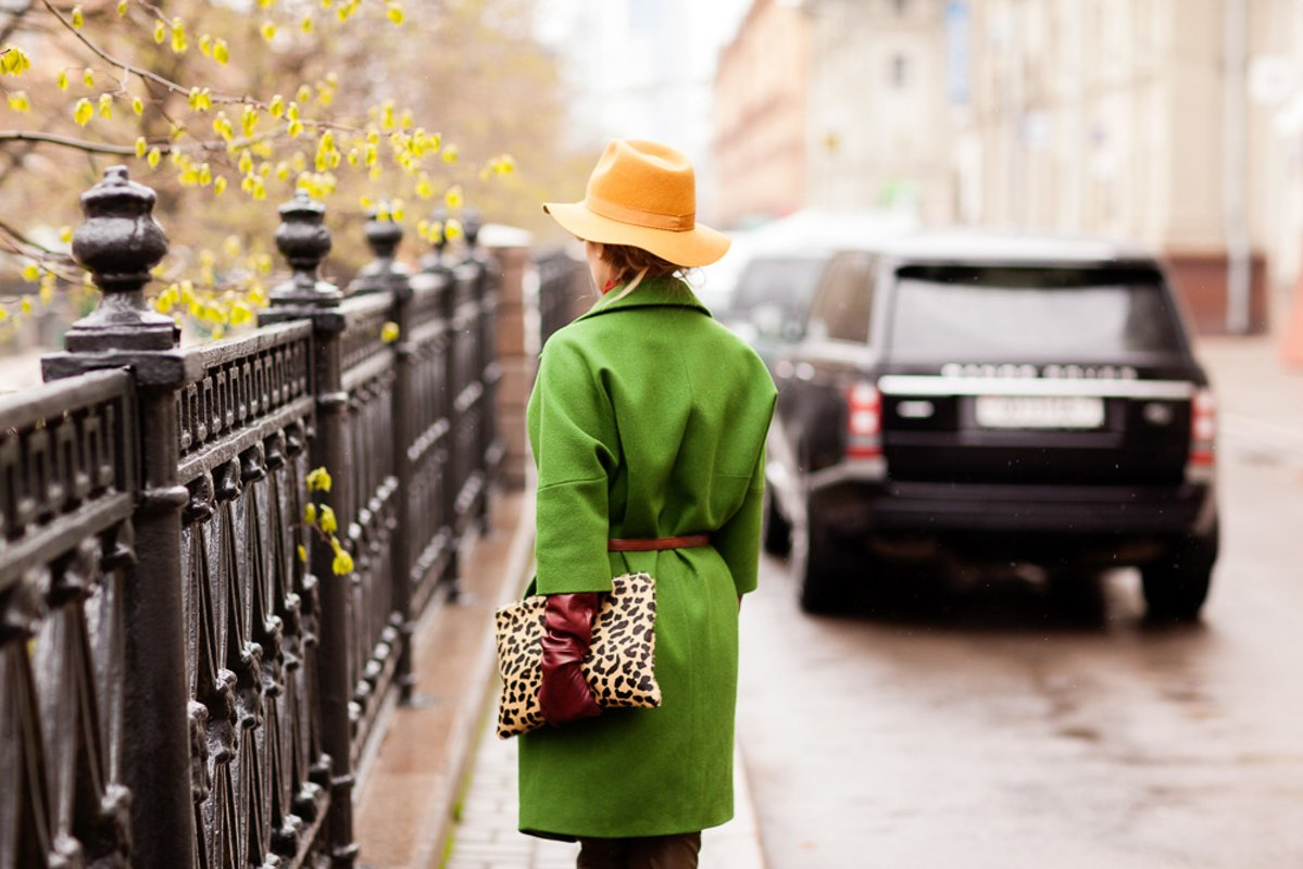 Details of clothes, girl in a green coat and brown hat example image 1
