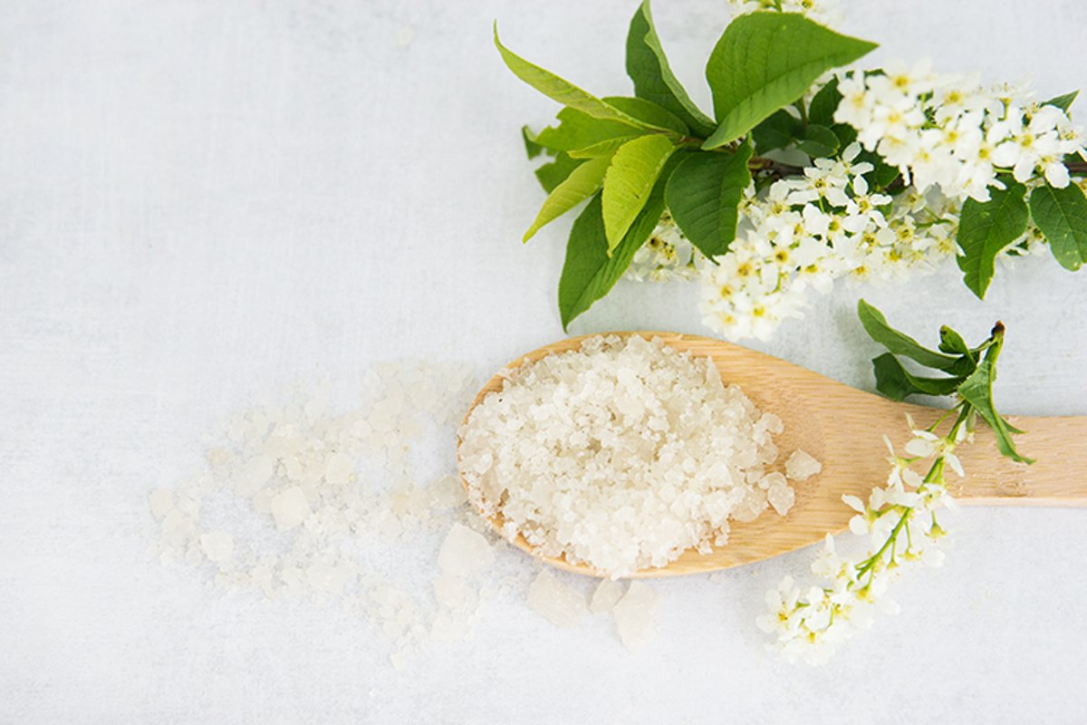 Spa-sea salt in a wooden spoon and shells example image 1