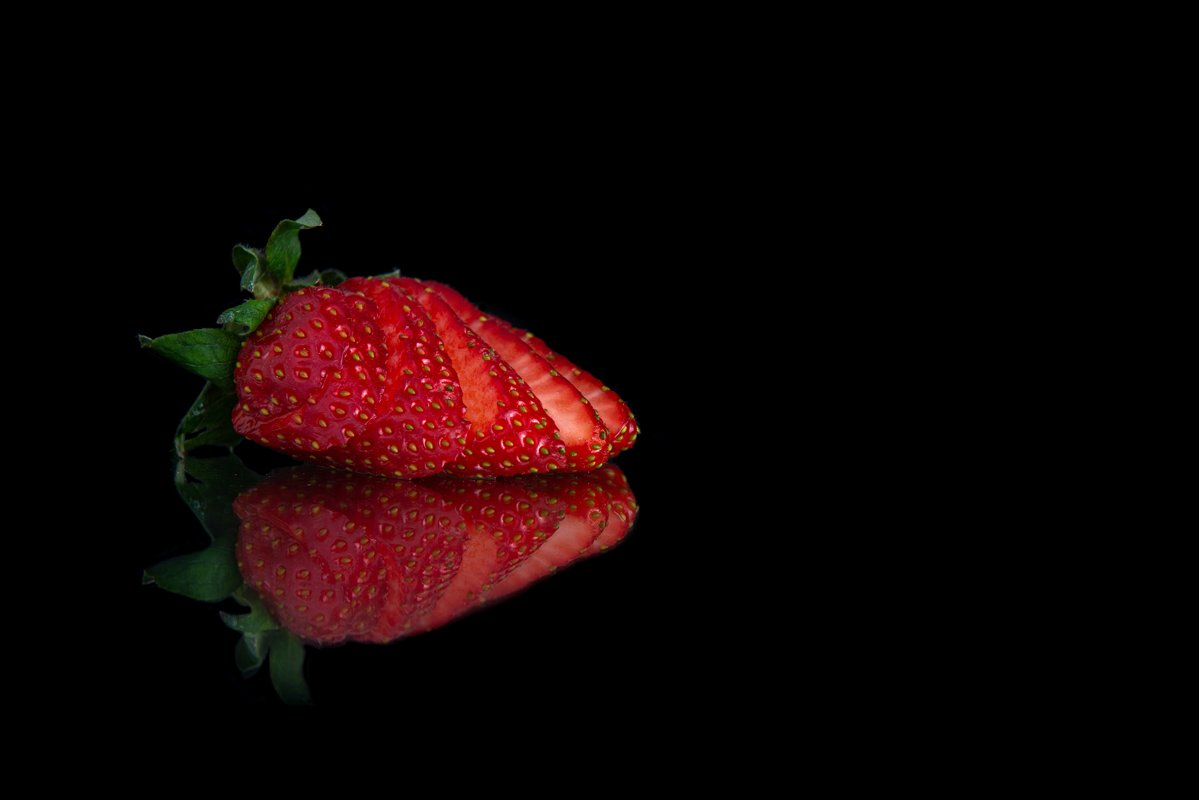 sliced strawberry with a place for text example image 1