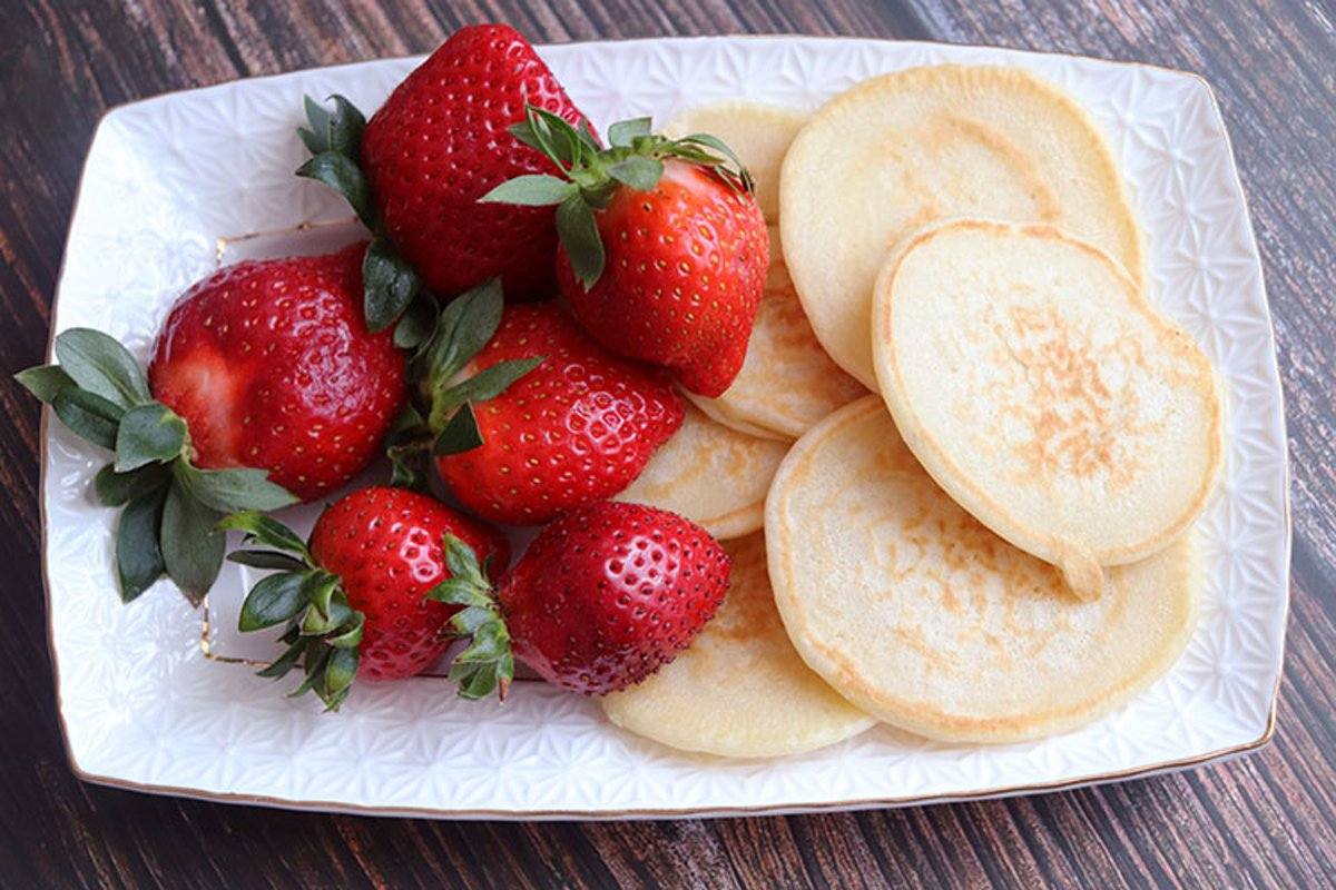Breakfast pancakes and strawberries close-up example image 1