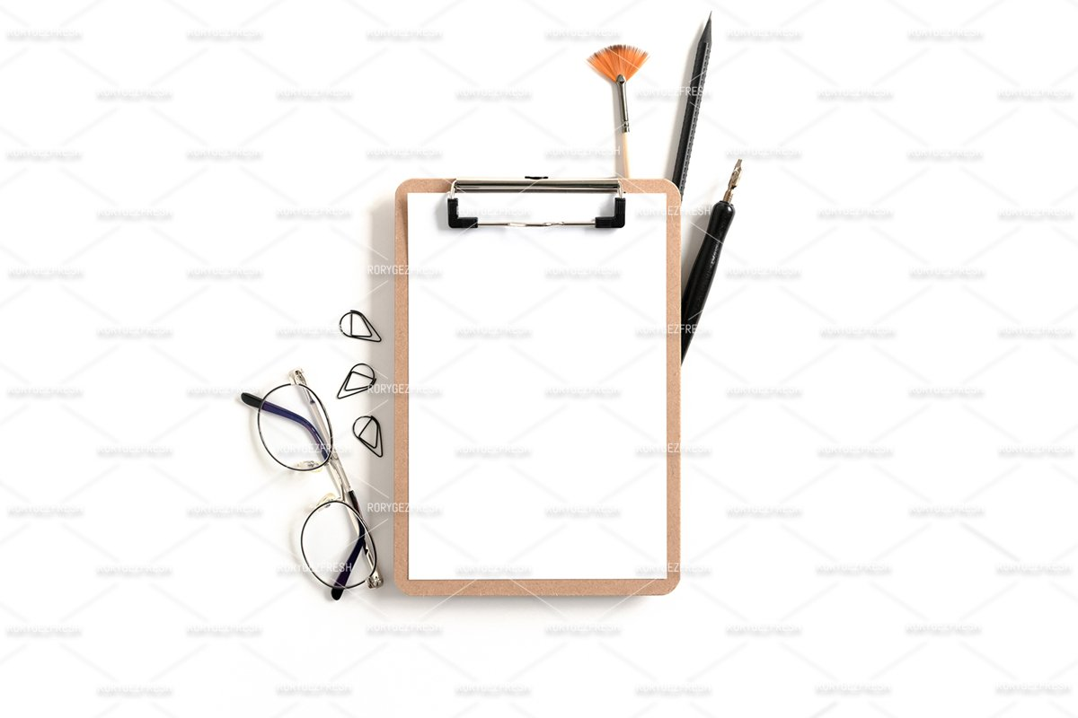 Clipboard mockup with frame made of stationery and glasses example image 1