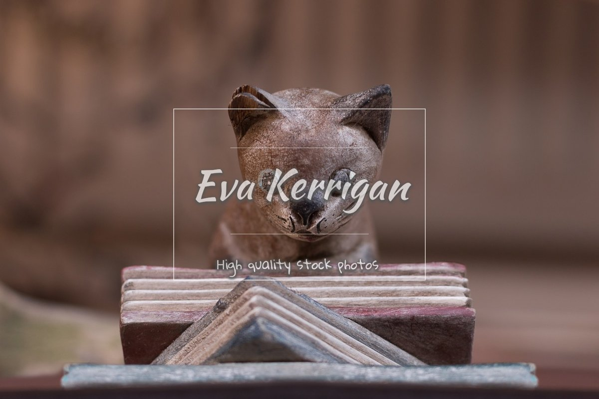 Wooden old statuette a book holder in the form of a cat. example image 1