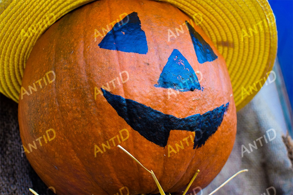 Jack-o-lantern with a yellow hat. Halloween example image 1