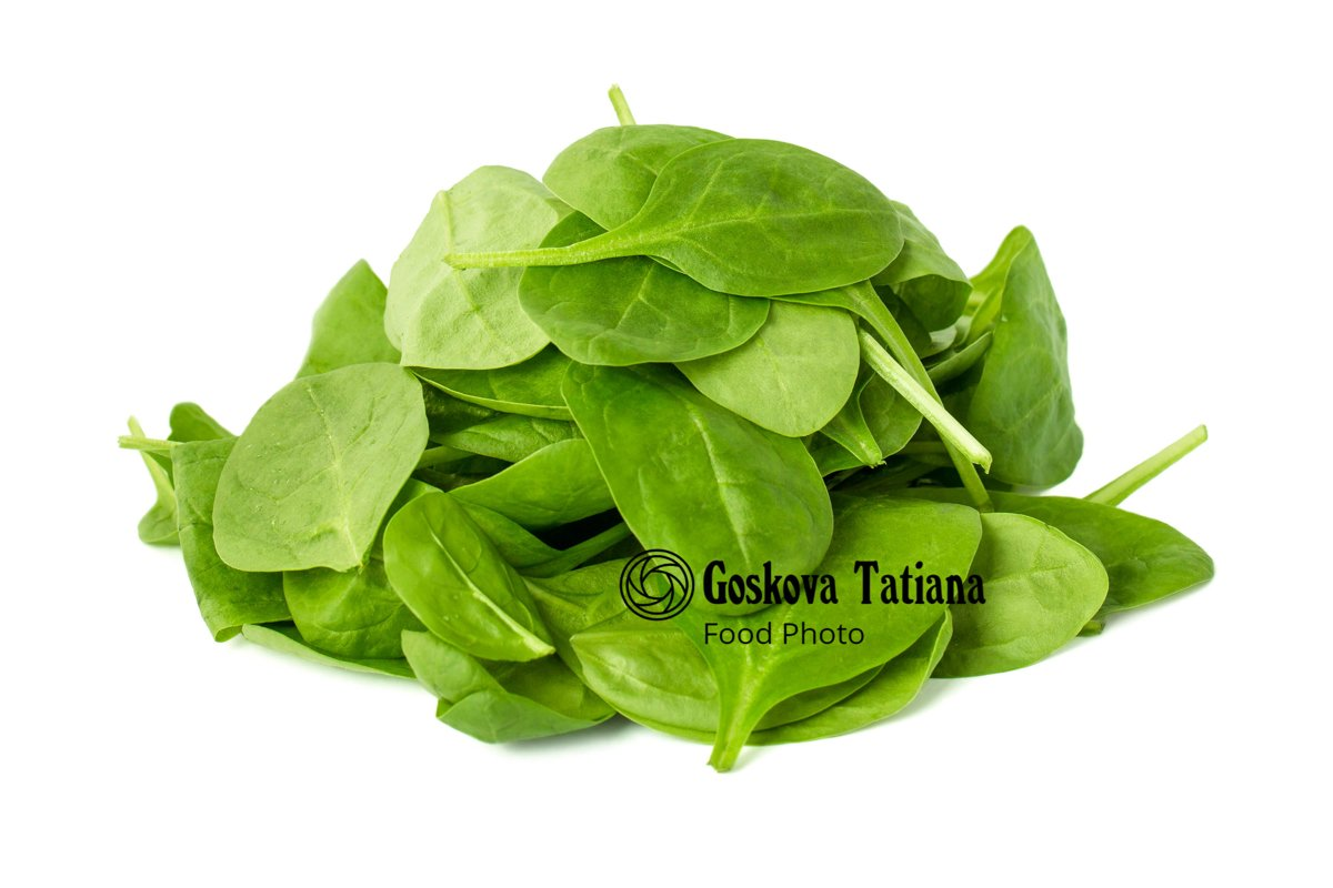 Photo of green leaves of spinach isolated on white backgroun example image 1