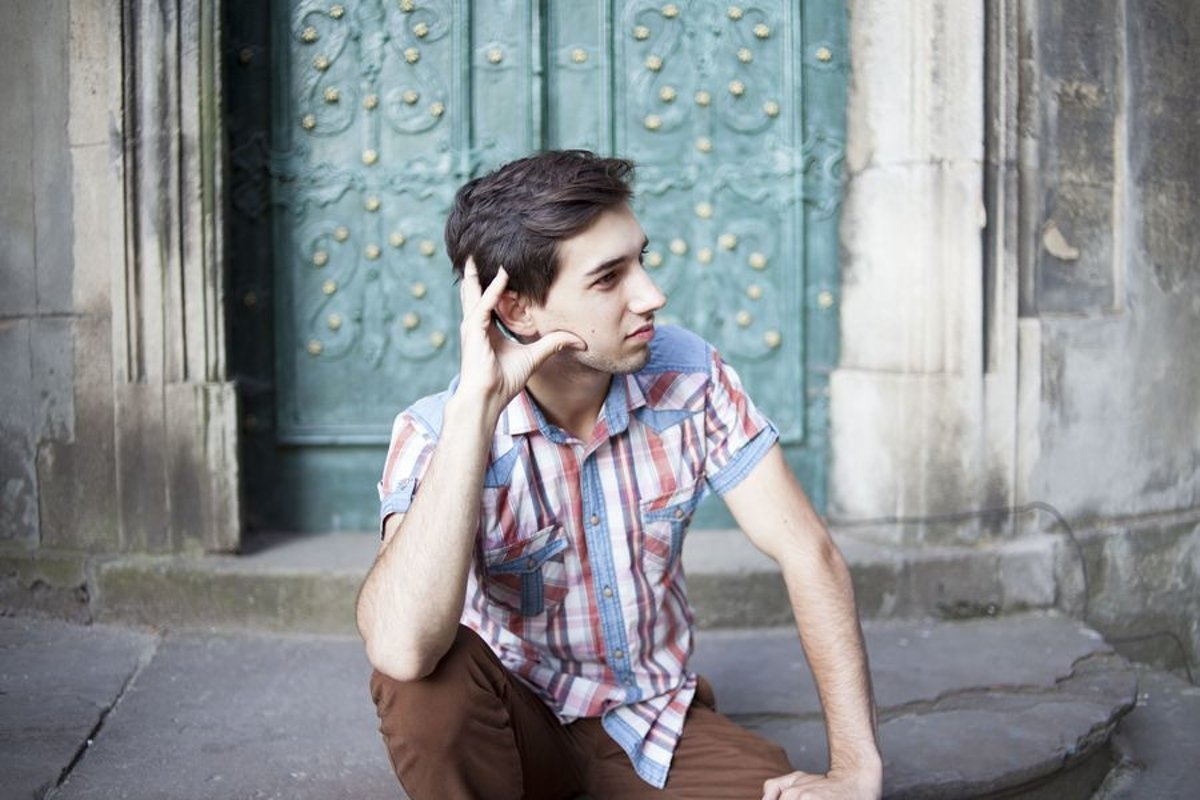 Young man walks in the city example image 1