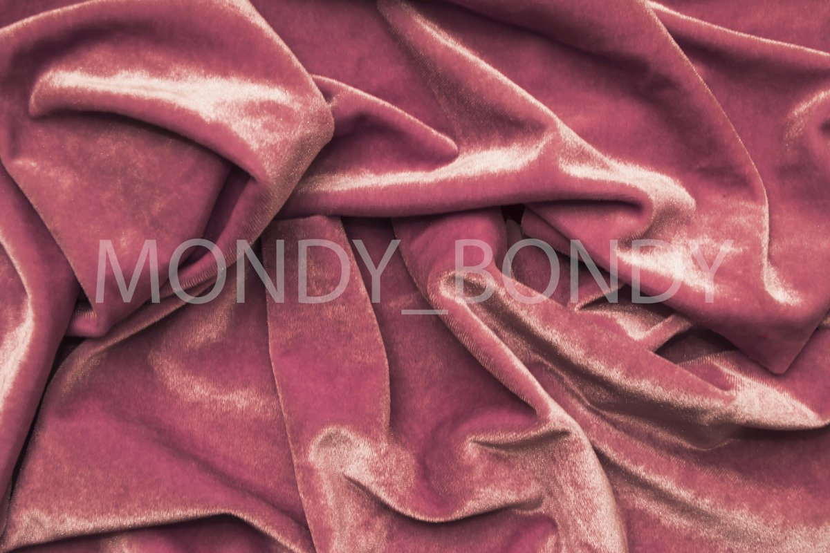 Texture of pink velvet fabric with irregular folds. example image 1