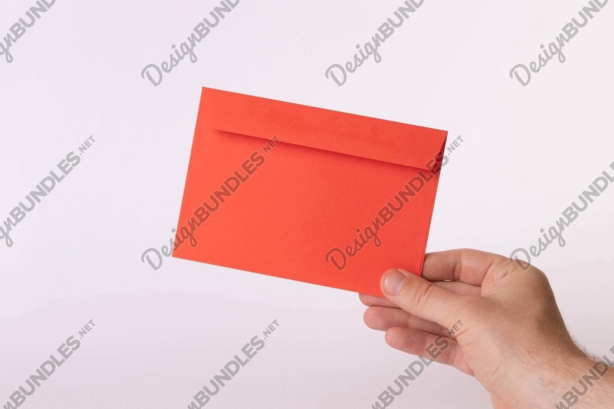 Stock Photo - Close-Up Of Hand Holding Blank Red Paper example image 1