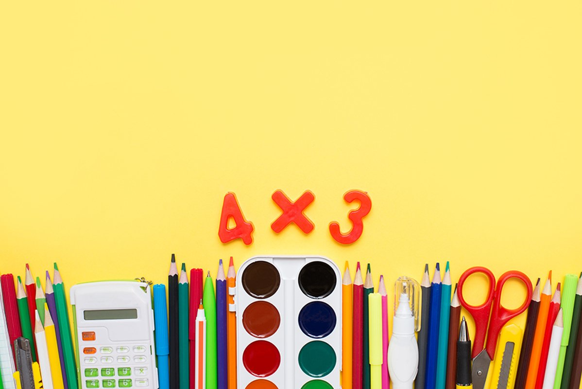 School accessories on yellow background. Flat lay example image 1