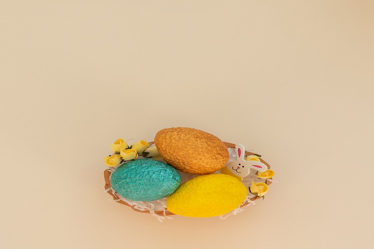 Easter eggs in egg basket with white paper example image 1