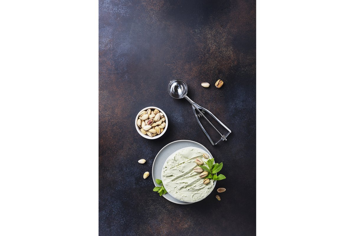 Homemade ice cream with pistachio and mint in ceramic bowl example image 1